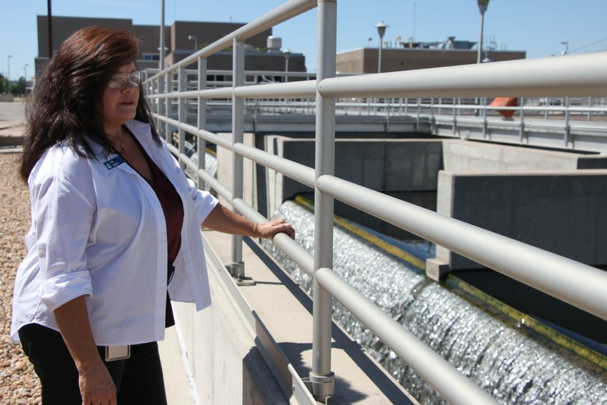 South Platte Water Renewal Partners outreach specialist Deb Parker watches the final stage of the wastewater treatment process, where cleaned water reenters the South Platte River. The plant needs millions of dollars in upgrades in coming years to fulfill state mandates.