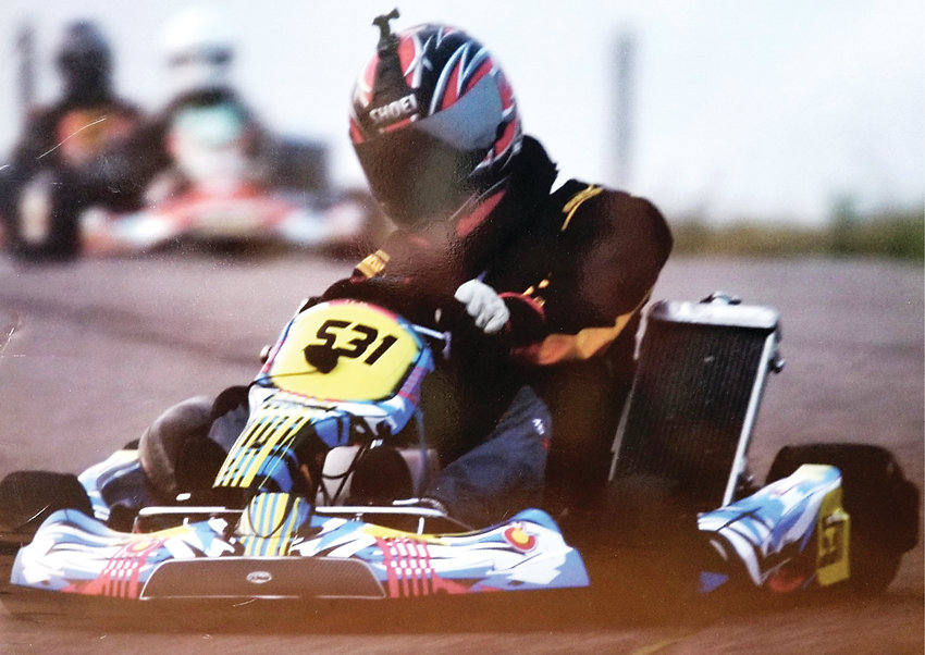 Christian Obrecht, a 47-year-old from Denver, turns his wheel in a kart race. Obrecht owns his own kart. In metro Denver and farther out, some tracks allow drivers to use their own karts.