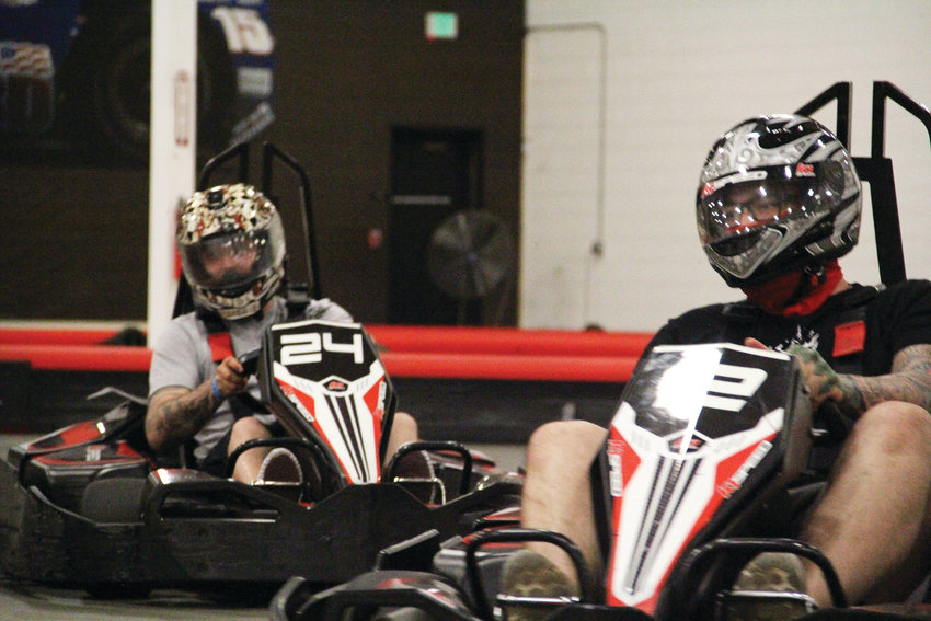 Tristan Johnson, 28, left, and John Wilson, 28, both from Denver, race at K1 Speed July 25.