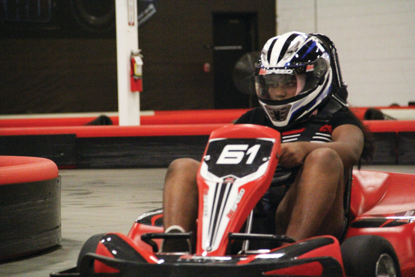 Bhavagnya Somala, 12, rounds a corner at K1 Speed July 25 in Highlands Ranch.