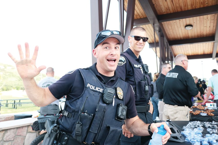 Sgt. Austen Schlecht strikes a pose as he keeps crowds entertained during National Night Out. Schlecht works in the police department's bike unit, riding an average of 15 or more miles a day on patrol.