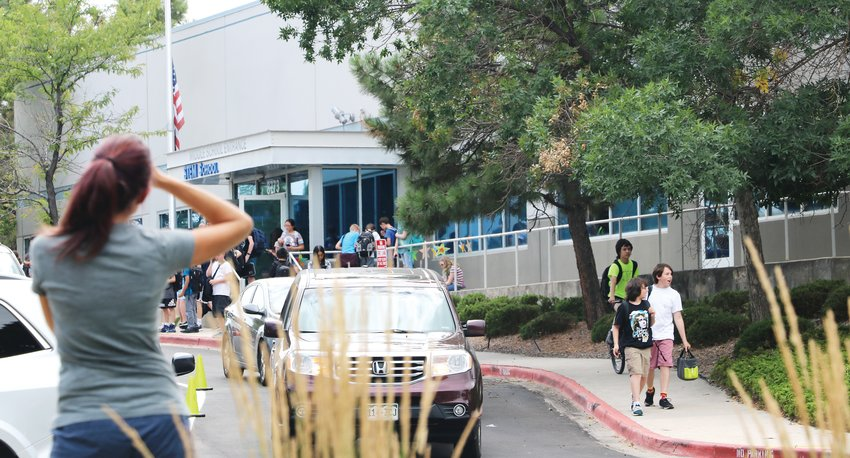 Parents pick up their children from the first day of school at STEM School Highlands Ranch on Aug. 7. The school has increased security and mental health resources following the May 7 school shooting.