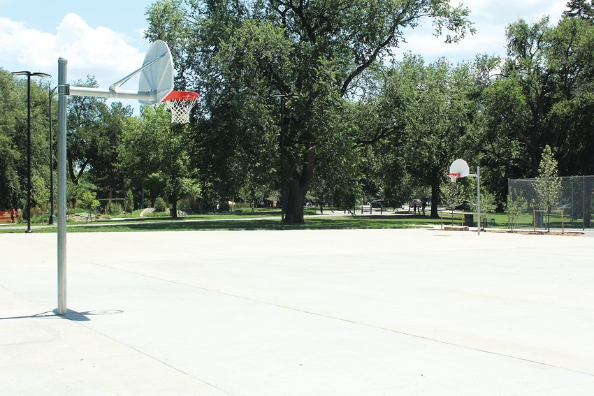 Denver Parks and Recreation recently opened the new basketball courts at Washington Park. The new courts, left, have two full courts, as well as seating and lighting. The old courts were smaller.