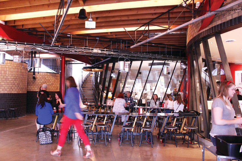 The factory space features windows where customers can look into the kitchen and see Little Man Ice Cream being made. Owner Paul Tamburello, said he picked West Colfax Avenue because he was born in the area and wanted to create a community space there.