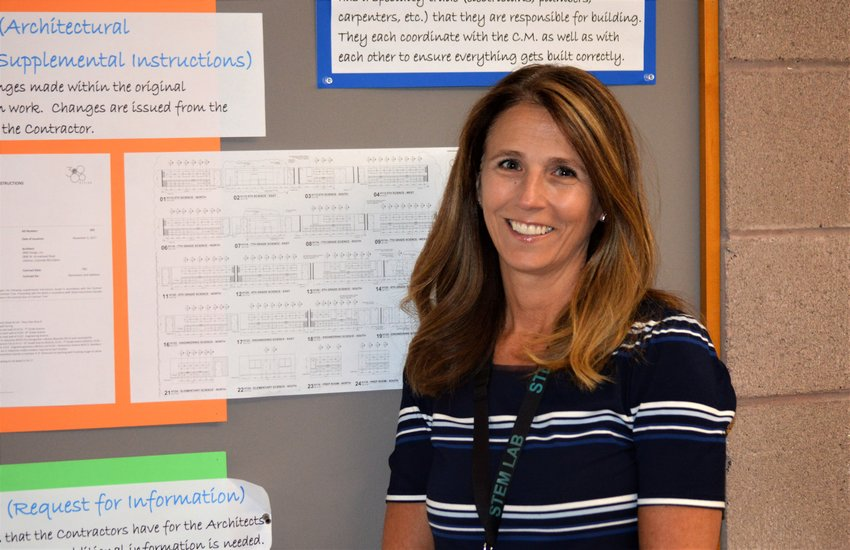 Principal Tracy Tellinger stands in front of a bulletin board students have used to keep track of the two-year construction project at Adams 12's STEM Lab k-8 school. Work wrapped up and the school opens for students on Aug. 14.