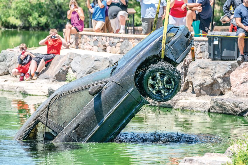 Divers searching for a gun found a stolen car in Ketring Lake on July 23, but how long it's been submerged is a mystery.