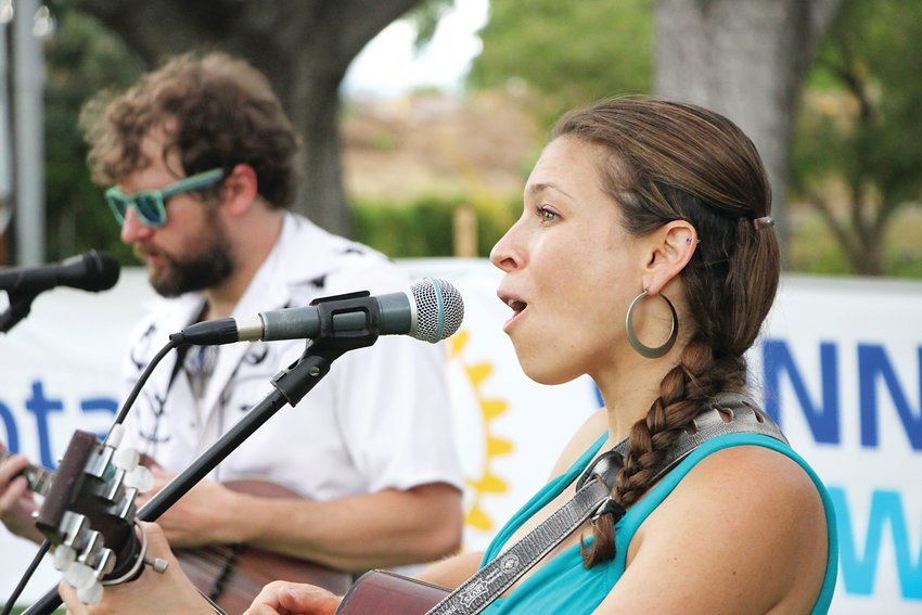 Daniella Katzir, right, and Spencer Crawford play bluegrass classics at the Rotary Club of Littleton's beer garden.