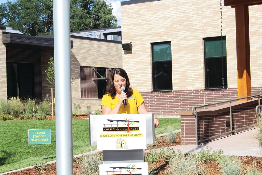 Cherrelyn Elementary Principal Rebecca Orsund welcomes school students, families and community members to the new school building on Aug. 9. She spoke about how generations of Englewood families have attended the school.