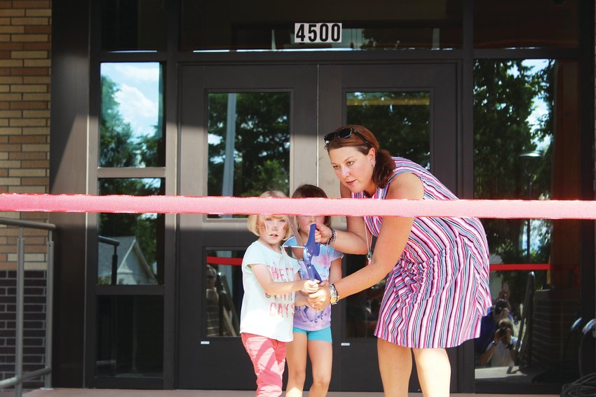 Englewood Schools Superintendent Wendy Rubin and future Cherrelyn Elementary students cut a ribbon, officially opening the new building. The school is home to around 230 students.