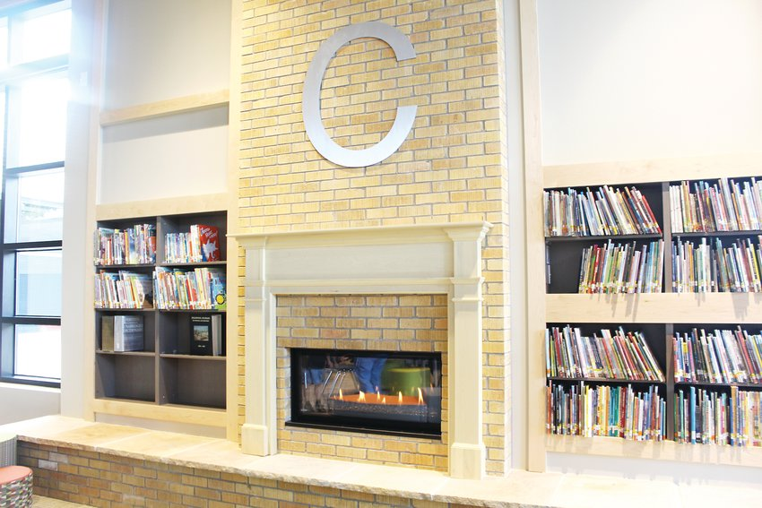 A fireplace inside the school's' library. The building was designed to make students feel like they are at home.