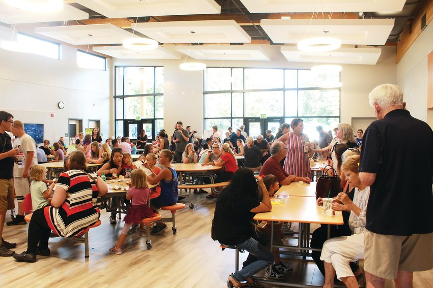 Community members pack the new school's cafeteria. Among those who attended the event included City Manager James Lewis and Councilmembers like Laurett Barrentine.