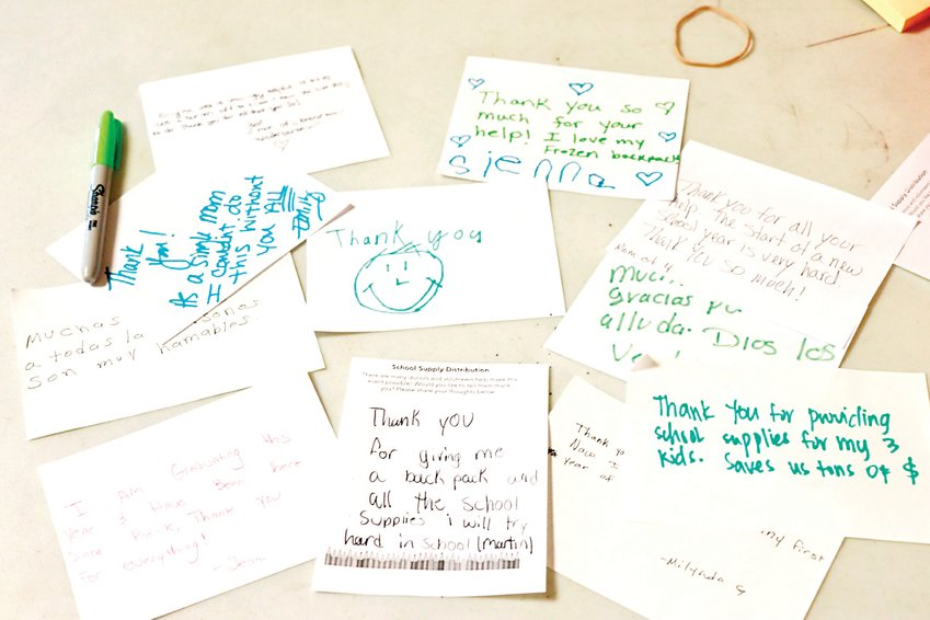 "After picking up their school supplies, students and parents wrote thank you notes to the Action Center and others who contributed to the event. ""Thank you for giving me a backpack and all the school supplies. I will try hard in school,"" one note reads."