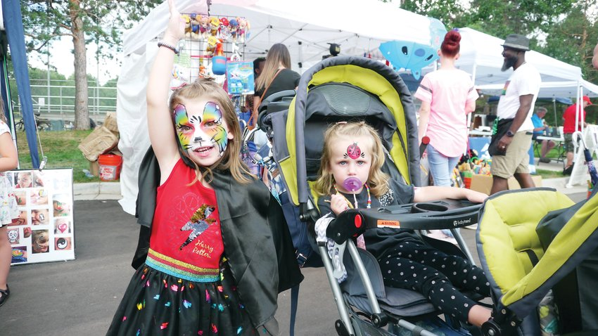 Cecelia Richardson, 4, and her sister Casandra, 2, pose after getting their faces painted by painter and owner of Face Painting Denver, Katharyn Grant. It was just one of many activities fit for kids.