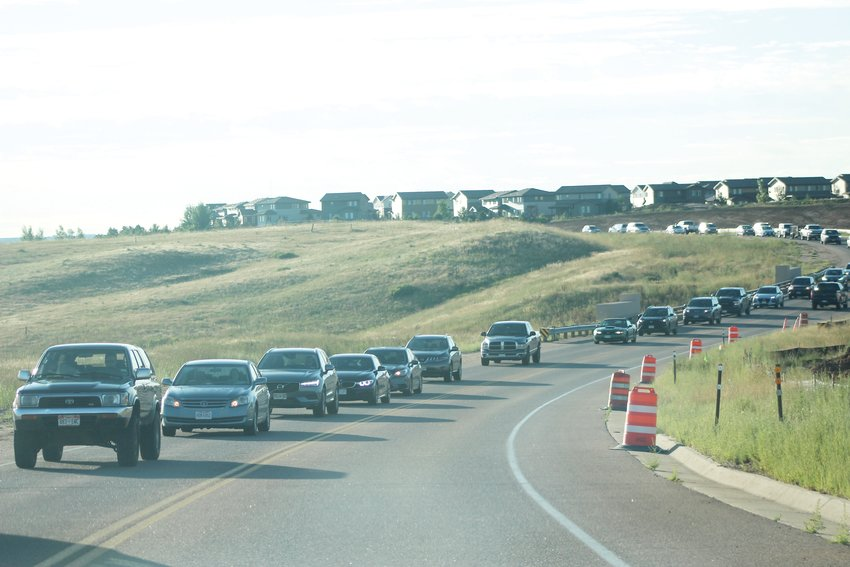 Cars travel west on RidgeGate Parkway from the Parker area during morning rush hour Aug. 12. The two-lane road will soon be expanded to four once the RidgeGate Parkway Widening Project finishes in 2021.