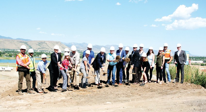 Wheat Ridge staff and elected officials celebrate a groundbreaking on Aug. 6 with representatives from Longs Peak Metropolitan District, Evergreen Devco, Inc. and Mortenson Construction for the construction of the hook ramps for westbound I-70 access on the future site of the Clear Creek Crossing development.