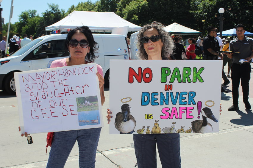 Ruby De Leon, left and Debbie Maslov protested the recent culling of Canada Geese during the inauguration event. The city of Denver recently rounded up more than 1,600 geese in order to control the population in Denver parks.