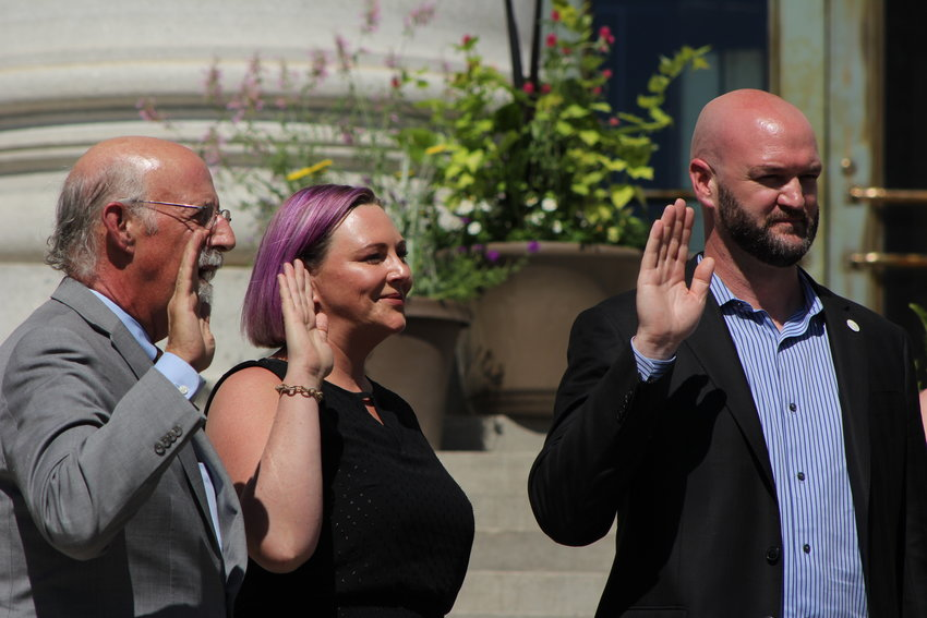 Councilmembers from left, Paul Kashmann, Amanda Sawyer and Jolon Clark were sworn in for the Denver City Council on July 15. The inauguration event was held on the front steps of the City and County building.