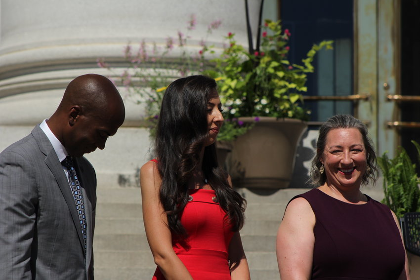 New Councilwoman Candi CdeBaca, center, stands on the steps of the City and County building to be sworn in with her fellow city council members. The inauguration event was held on July 15.