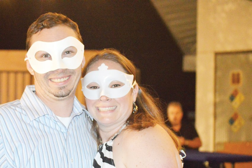 Masqueraded Andrew and Mary-Frances Bigoney, of Erie, pose in the bar at Northglenn's Magic Festival Aug. 17.