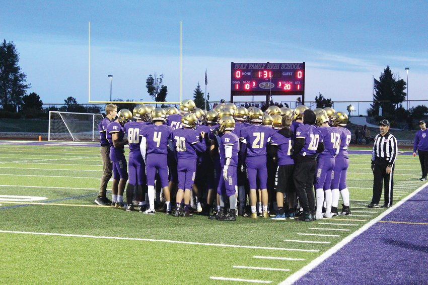 Holy Family football huddles as a team before their contest September 2018 against Skyline.