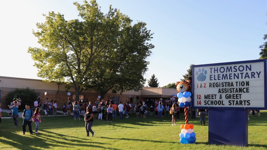 Elementary school students and parents gather together on the front lawn of Thomson Elementary School for their first day back on Aug. 14.