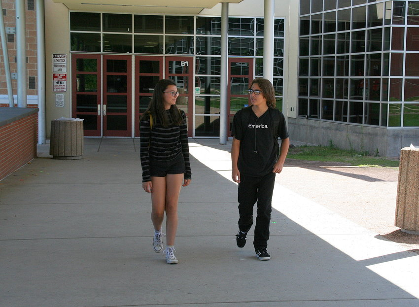 Grace Emory, left, and Scott Denison, who are two of Golden High School's nearly 400 incoming freshmen this year, walk through the breezeway between the school's two buildings as they make their way to their respective classrooms on freshmen orientation day, which took place on Aug. 14.
