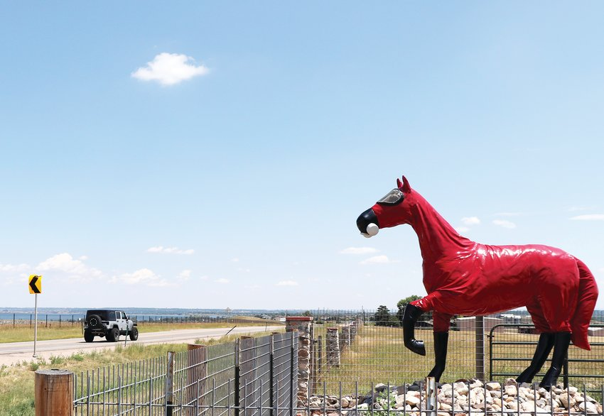 The Cold War Horse sculpture at the former Rocky Flats site off of Highway 72. The statue wears a hazmat suit and respirator as a reference to the contamination found in the soil of Rocky Flats.