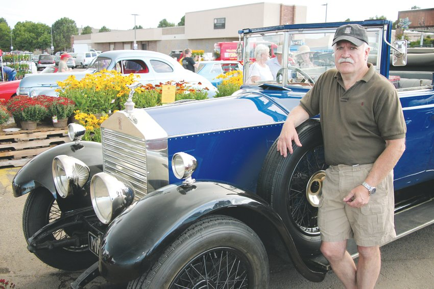 Herb Goede stands beside his 1925 Rolls Royce at O'Toole's Garden Center. With only 20 horsepower, the Rolls is good for rolling around in, but it's not highway material.