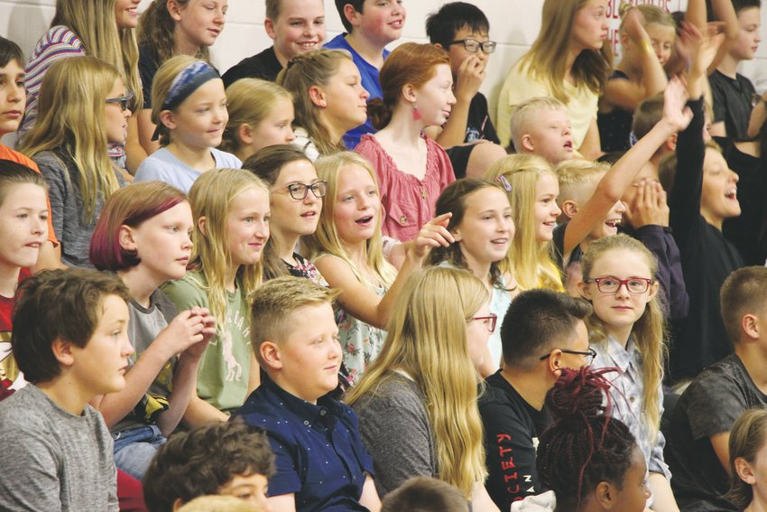 Students pack the bleachers in Newton Middle School's gym for a first-day pep assembly.