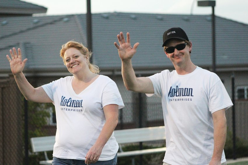 Chris and Louise Helton wave as they walk around the track at Shea Stadium in Highlands Ranch for the 2019 Relay for Life Aug. 17.