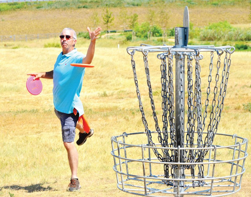 "Highlands Ranch resident Chris Ball found time to become a good disc golf player while also being a Grammy nominated songwriter and composer of background music for many television shows. ""I've never been good at regular golf, but disc golf was something I could do,"" Ball said."