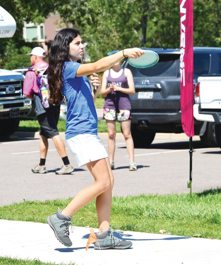 Paige Bjerkaas is the sixth ranked player in the world and the 22-year-old won the Open division at the Rocky Mountain Women's Disc Golf Championship which was held Aug 2-4 in Superior. She was 13-under par with a three-round total of 152 and pocketed $1,000 for the win.