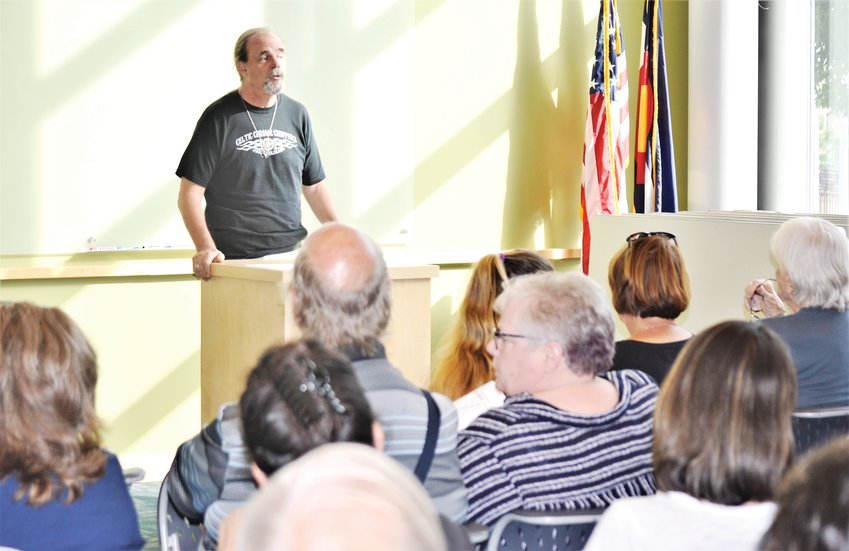 Shaw Heights resident Ken Biles discusses a mixed-use development proposal for 235 acres around the Pillar Fire Church with a roomful of worried neighbors. Developers Oread Capital have been shopping their proposal among neighbor groups. They'd need approval from the City of Westminster to proceed.