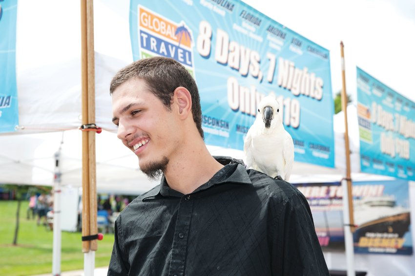 Andrew Syddall of Arvada, and companion Sidney, a 26 year-old citron crested female cockatoo, were among the performers at this year's Northglenn Magic Fest Aug. 17 at the Northglenn Community Center.