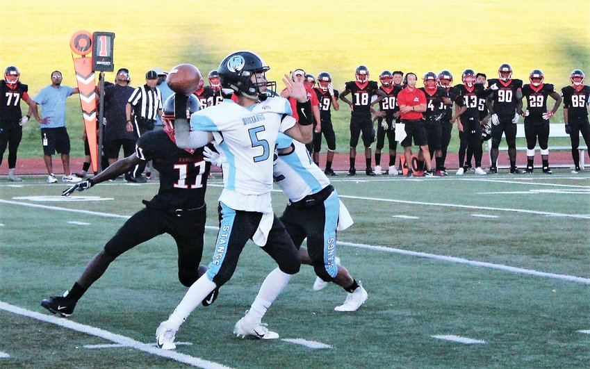 Upcoming Mountain Range junior quarterback Clayton Do attempts the pass Sept. 13 against Rangeview.