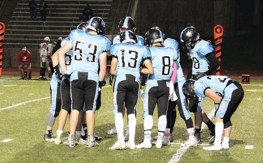 The Mustangs huddle up offensively against Smoky Hill Oct. 19 at North Stadium.