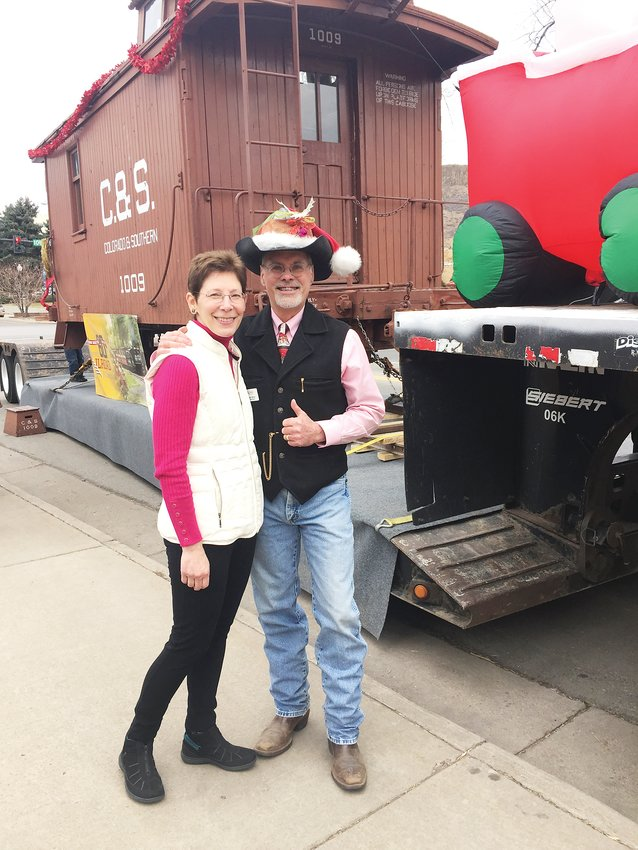 Donald Tallman and his wife Robin get ready for last year's Olde Golden Christmas and Holiday Parade. Donald Tallman will be retiring from the Colorado Railroad Museum at the end of August. Robin Tallman retired last year, and the two are looking forward to having more adventures together.