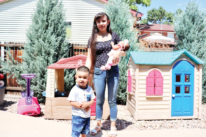 Yvette Martinez Madera and her children, Damian and Leilani, together in the backyard at the Hope House residential home.