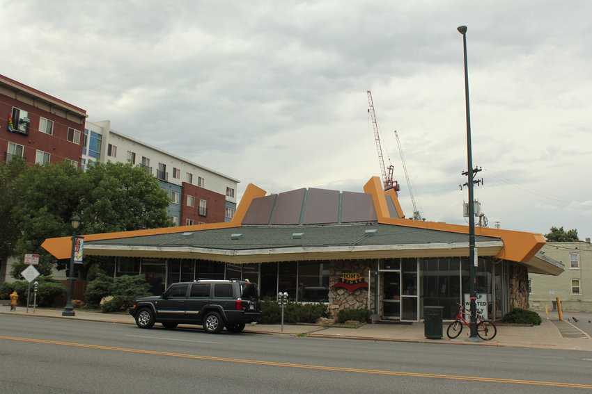 Five Denver residents worked together to raise funds for a historic landmark application for Tom's Diner. The restaurant sits on the corner of East Colfax Avenue and Pearl Street.