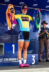 Chloe Dygert-Owen shows off her three jerseys as winner of the Golden stage, queen of the mountain (QOM), and sprint leader.