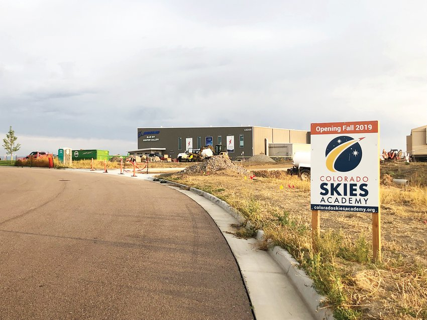 Colorado Skies Academy, an aerospace-focused middle school, is open for classes. The location shown is a temporary grounds for the school while its building continues to be finished at the same address, 13015 Wings Way, Englewood, CO 80112. Despite its location far from Englewood, it carries an Englewood mailing address because the area is unincorporated Arapahoe County, meaning it's not within a city or town. The large gray building is the Boeing Blue Sky Aviation Gallery, which opened in July 2018.