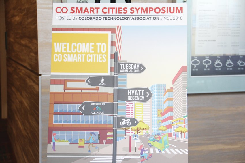 A sign stands at the CO Smart Cities Symposium Aug. 20 in downtown Denver. The event at the Hyatt Regency hotel was hosted by the Colorado Technology Association in partnership with the Colorado Smart Cities Alliance.