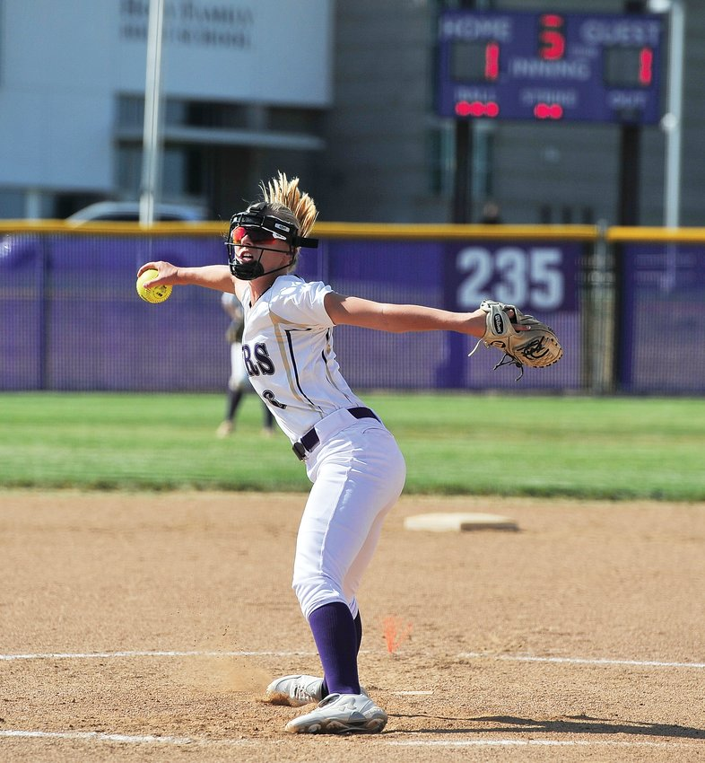 Holy Family pitcher Cassidy Chvatal delivers a pitch against Wheat Ridge during the Tigers' opener on Aug. 20 at Holy Family High School in Broomfield. Chvatal surrendered only one run, as Holy Family won, 8-1.