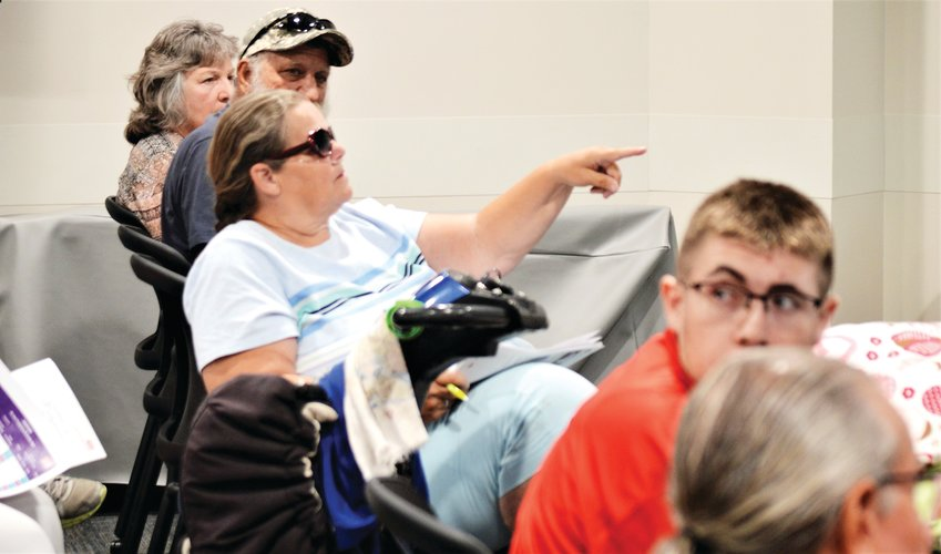 Thornton resident Cathy Millet asks a question about bus route changes Aug. 19 in Thornton City Hall during an update session RTD staffers hosted about the new N-Line commuter rail and its supporting bus routes.
