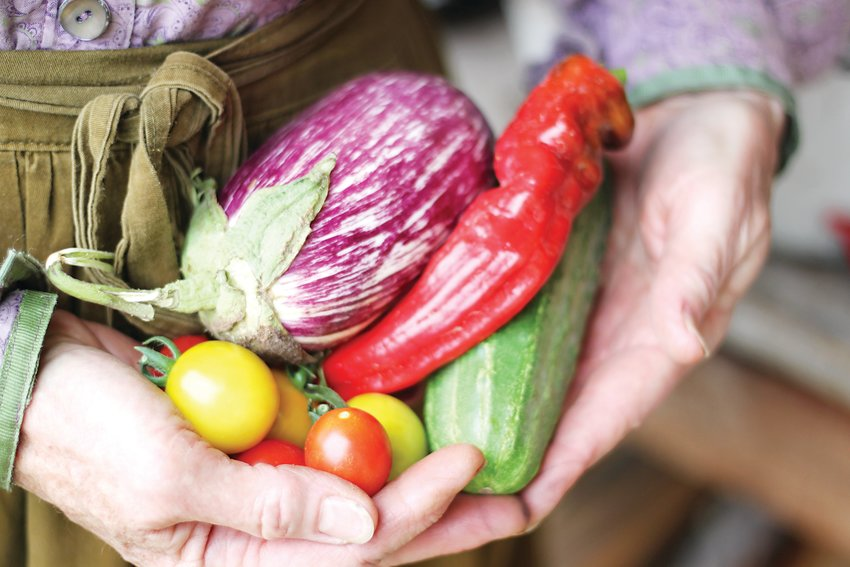 Owens-Tucker holds the fruits of her labor, all heirloom varieties grown organically.