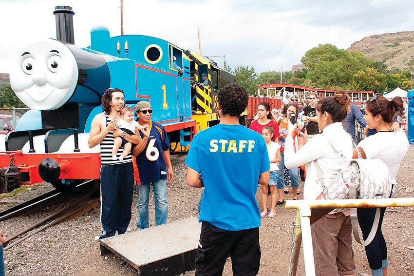 A group of attendees from a past year gather for photo ops with Thomas the Tank Engine. The Colorado Railroad Museum in Golden is hosting the A Day Out With Thomas event this year on the first three weekends in September.