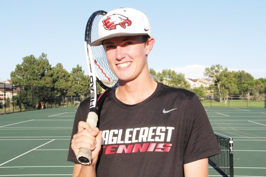 Schuyler Wilcox, an Eaglecrest senior, stands at the tennis court after practice.