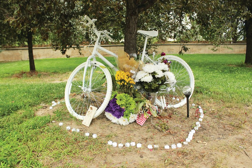 Alexis Bounds' ghost bike stands at the intersection of South Marion Parkway and East Bayaud Avenue where she was killed on July 24. Ghost bikes are placed as memorials of the person who was killed.