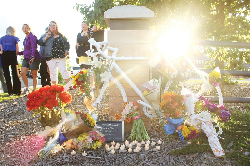 "A memorial event was held on Aug. 9 for Edward ""Chuck"" Vogel in Parker. Mourners placed flowers and electric votive candles around the bike, which was placed near the intersection where Vogel died."
