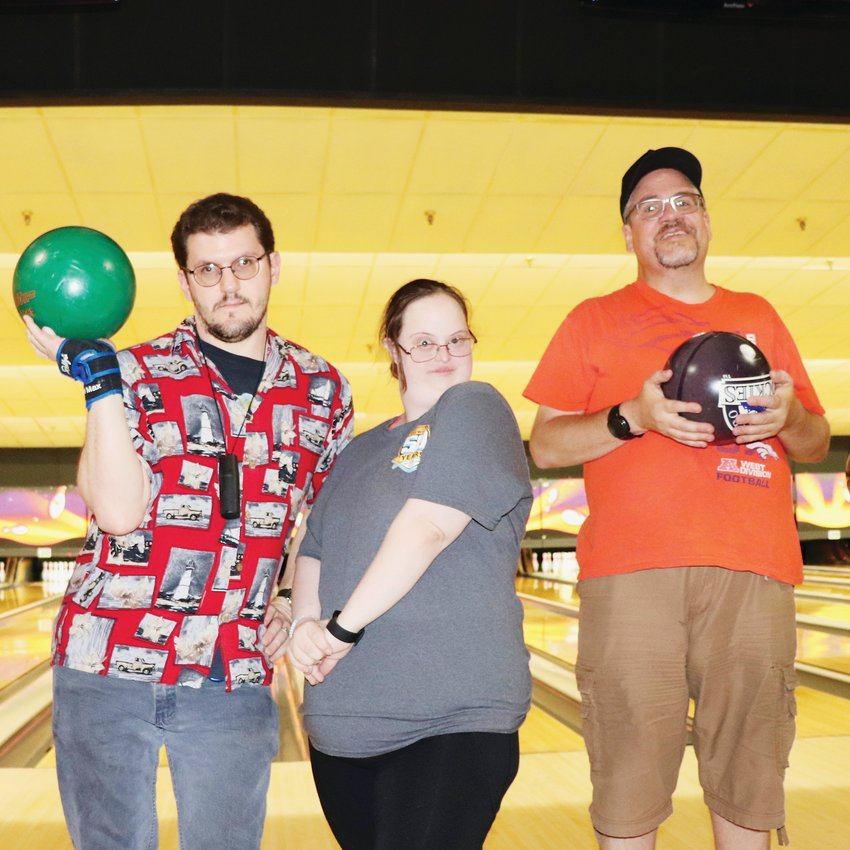 Rick Lorie, left, with friends Elaine and Tommy. The group often joins South Suburban Adaptive Therapeutic Recreation for Saturday morning bowling at AMF Belleview Lanes, 4900 S. Federal Blvd.